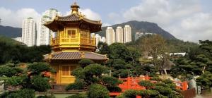 golden pavilion, red wooden bridge, trees, rocks, high rise buildings, blue sky, white cloud