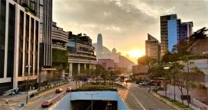 Tsim Sha Tsui, skyscrapers, sunset, roads, cars